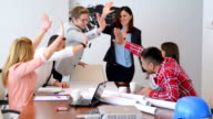 DOLLY: Cheerful young professionals in meeting room video