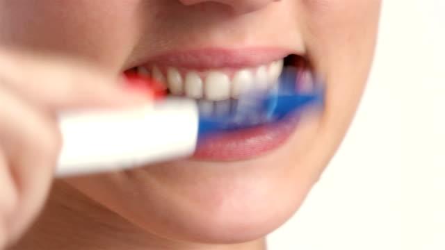 Cheerful young woman brushing teeth. video