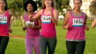 Cheering women winning breast cancer marathon video
