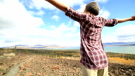 Cheering young woman enjoying freedom in nature video