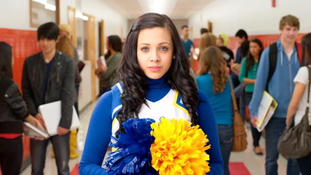 Cheerleader stands in front of camera video