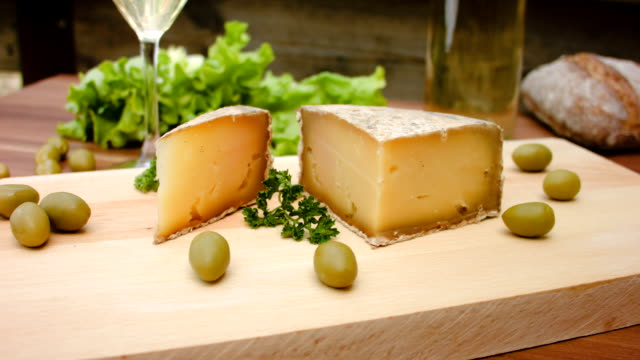 Cheese made from sheep's milk on a wooden board video