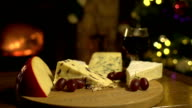 Cheeseboard and wine at Christmas with Fireplace, DOLLY video