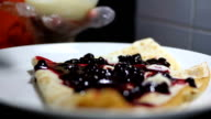 Chef add cream to pancake with berry jam video