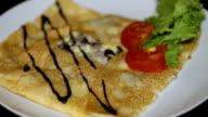 Chef add sauce to pancake video