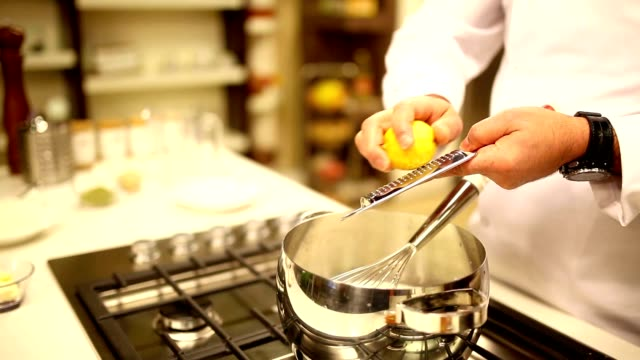 Chef adding lemon zest video