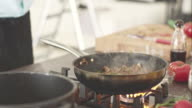 Chef adds herbs into meat sauce video