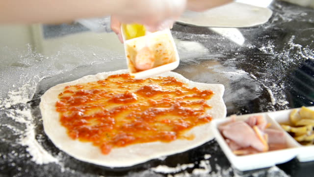Chef baker making pizza at kitchen video