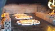 Chef baker making pizza at kitchen video