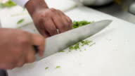 Chef cooking and cutting vegetables video