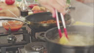 Chef cooking pasta in boiling water video