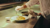 Chef cooking, preparing food, pasta, professional cook in restaurant kitchen video