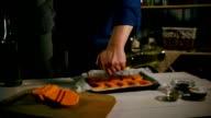 Chef cooking pumpkin dish. Chef praparing baked vegetable. Pumpkin baking dish video