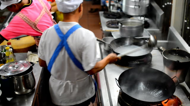 Chef cooking with a flaming pan. video