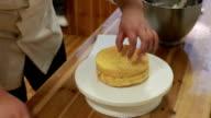 chef cut cake in half and spread cream video