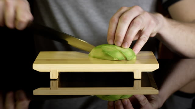 Chef cutting avocado video