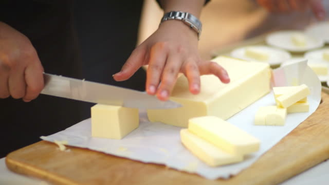 Chef Cutting Cheese on Board video
