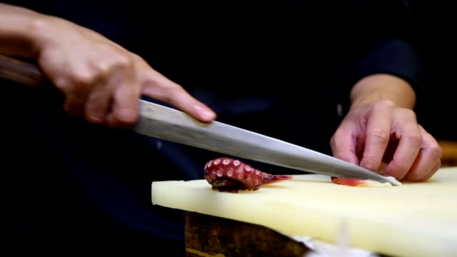 Chef cutting squid. video