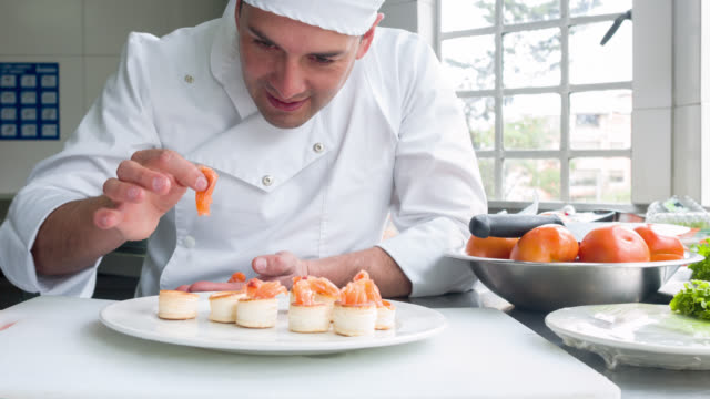 Chef decorating a plate video