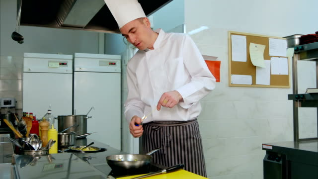 Chef doing flambe with vegetables video