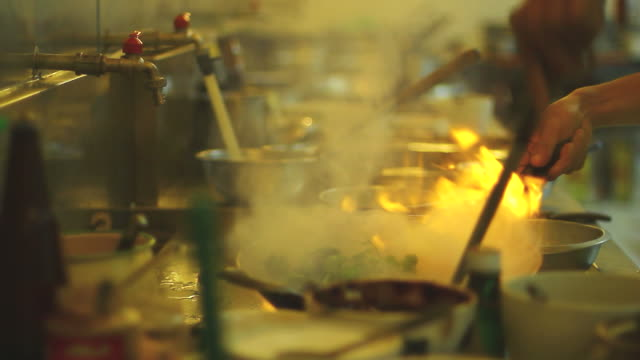 Chef flame cooking in restaurant video