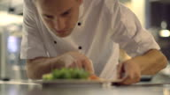 MS R/F Chef giving finishing touches to dish video