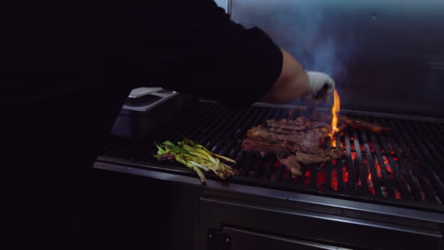 Chef Grilling Meat and Onions in Taqueria video