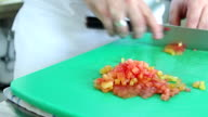 Close-up chef hands cooking and preparing vegetable food in restaurant kitchen video