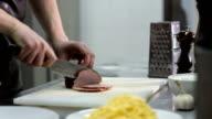 Chef hands cuts ham for Carbonara video