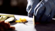 Chef is chopping yellow bell pepper, closeup. video