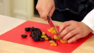 Chef is cutting dried apricots and prunes video
