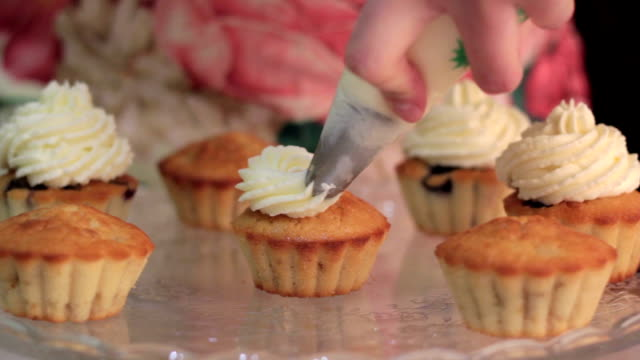 Chef is decorating cupcakes for a party video