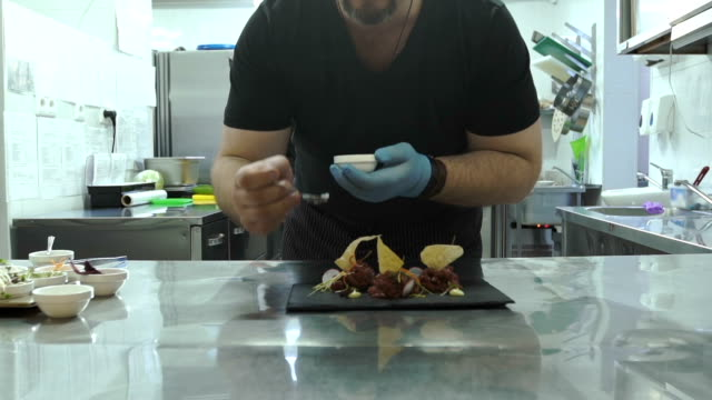 Chef is finishing gourmet meal video