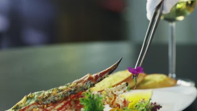 Chef is Garnish Dish with Lobster in Luxury Restaurant video