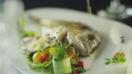 Chef is Garnishing Fish Dish in Luxury Restaurant video