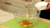Chef is Mixing Salt and Spices with Chicken Eggs in a Glass Bowl video