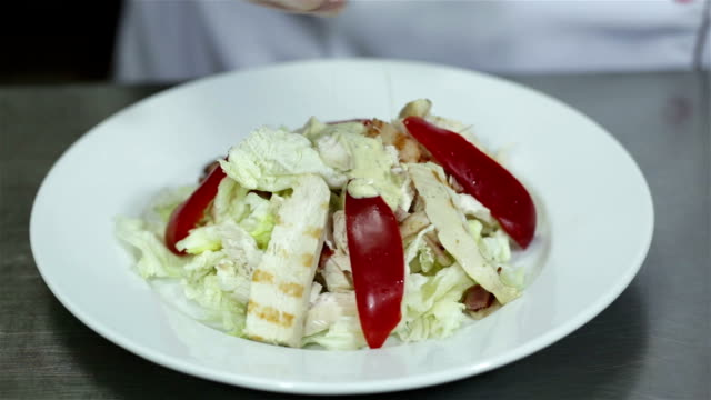 Chef is preparing Caesar salad at the restaurant. video