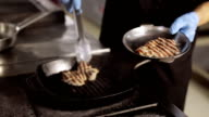 Chef lays out steak from griddle to steal bowl. video