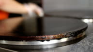 Chef lubricating pan with oil and preparing pancake video