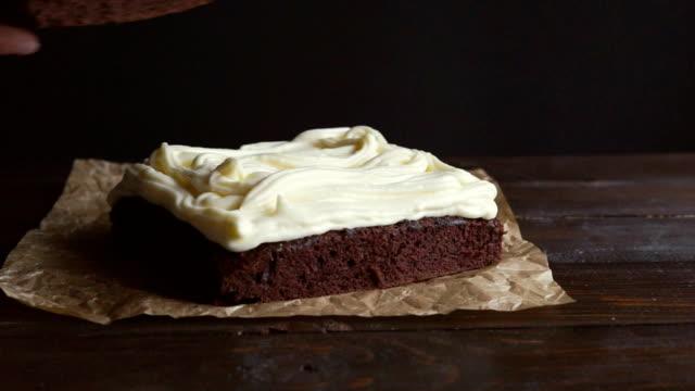 Chef making chocolate cream. Close up of chef put cake layer on cream video
