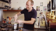 Chef Making Hollandaise Sauce in Small Cafe Kitchen video
