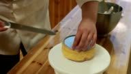 chef move baked cake from cakestand video
