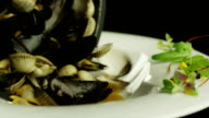 Chef Pouring Boiled Oysters into Plate. Close-Up. video