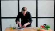 Chef pours sliced meat with sauce video