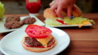 Chef prepares a hamburger with onions video