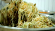 chef prepares vegetarian salad of cabbage, mushrooms, carrots and fresh herbs video
