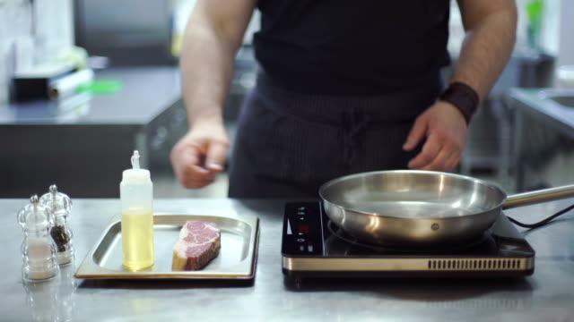 Chef preparing beef steak video