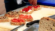 Chef preparing bruschetta with trout and fruit. video