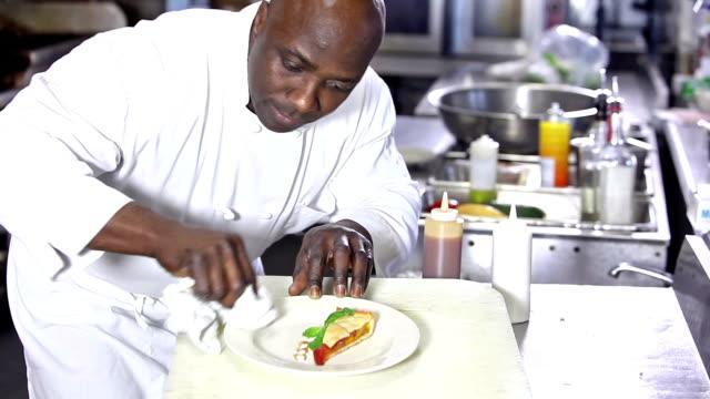 Chef preparing elegant gourmet dessert video
