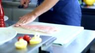 Chef preparing fillet of fish video